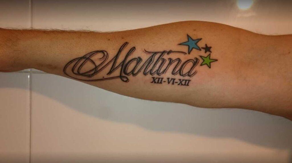 JuanPe Tattoo colage de tatuajes inscripcion y numeros romanos en antebrazo