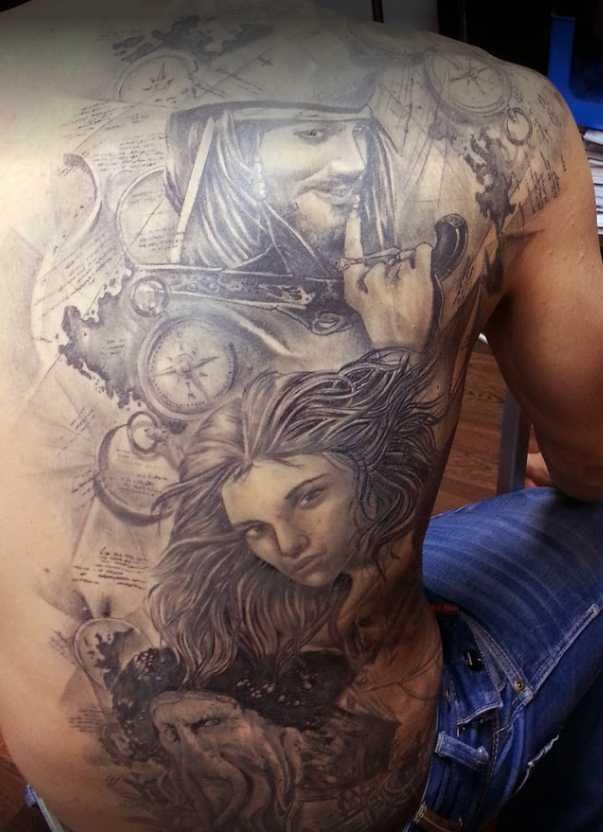 JuanPe Tattoo espalda completa piratas y mujer