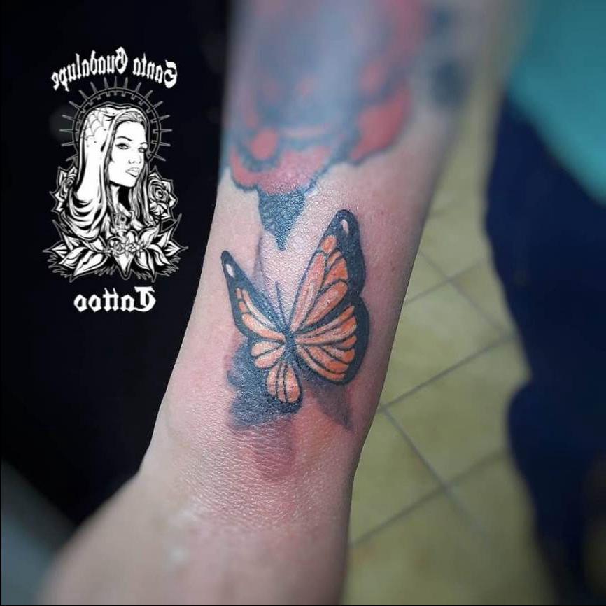 Tatuaje de Mariposa en el Brazo