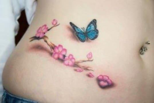 Tatuajes de Mariposas Azules con rama de flores rosas