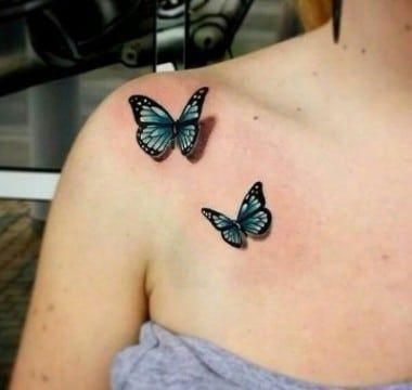 Tatuajes de Mariposas Azules dos mariposas en hombro y clavicula