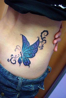 Tatuajes de Mariposas Azules en espalda baja mujer