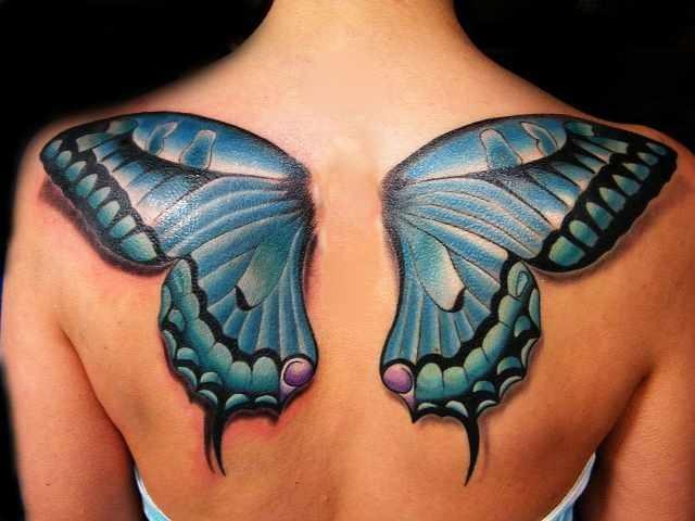 Tatuajes de Mariposas Azules gran tamano en espalda tipo alas de angel las dos pintadas