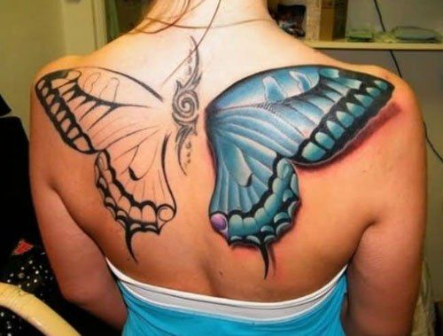 Tatuajes de Mariposas Azules gran tamano en espalda tipo alas de angel una pintada y la otra no