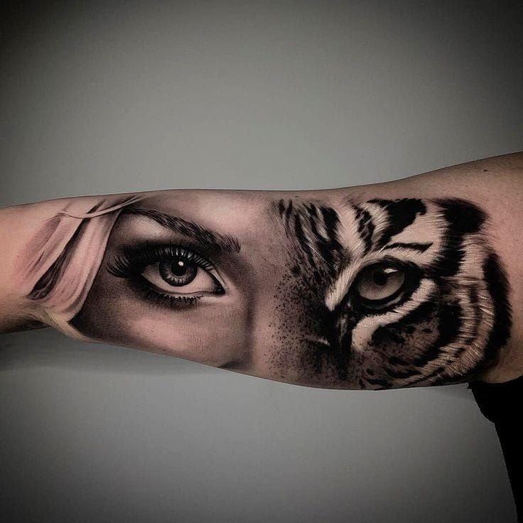 Tatuajes en el Brazo rostro mitad tigre mitad mujer