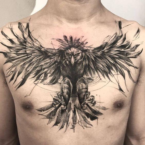 Tatuajes en pecho completo hombre cuervo con disenos geometricos
