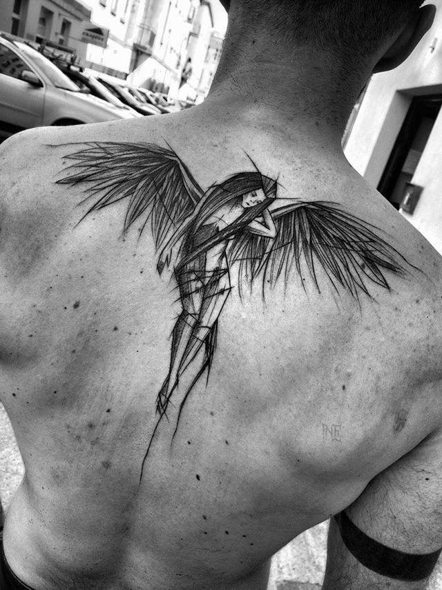 tatuaje espalda completa hombre mujer alada