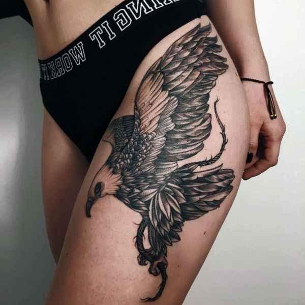 tatuajes y sus significados aguila en pierna muslo mujer