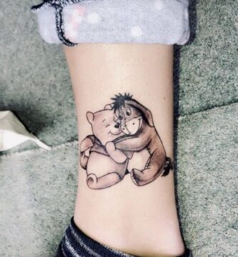 winnie pooh y amigo tatuaje